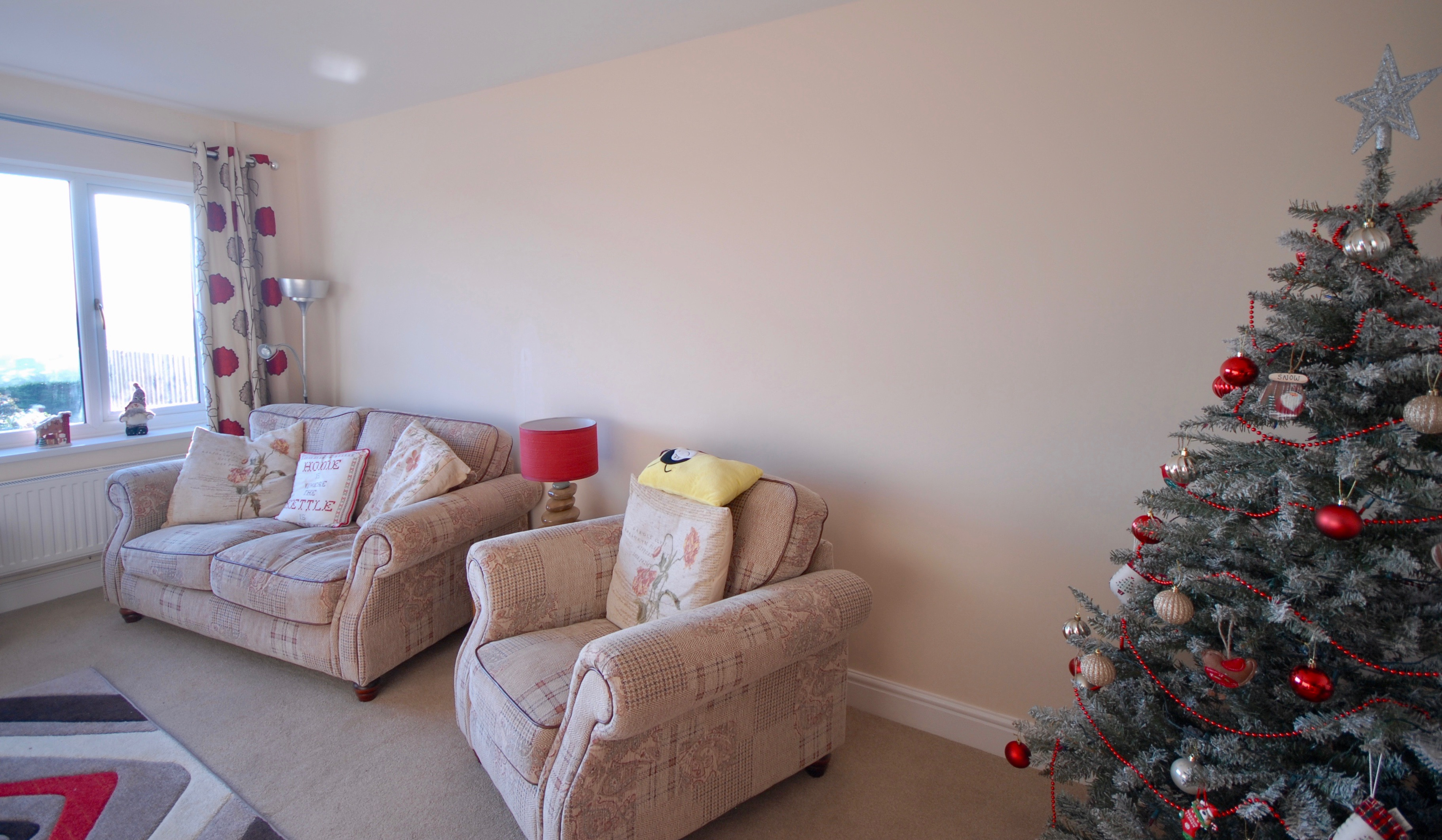A Christmas spruce up of walls, ceilings and woodwork in Llanelli, Carmarthenshire. The use of light colours gave the room a larger appearance.